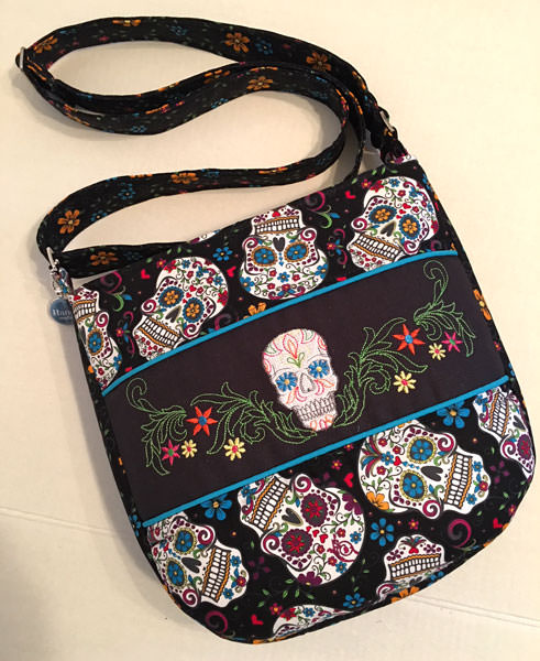 How great are these sugar skulls and that coordinating blue piping?! Summertime Sling - Andrie Designs