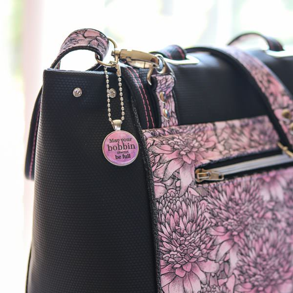 How perfect does this pink swing tag look on this bag! - Andrie Adornments