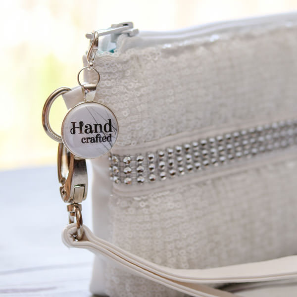 White would make a stunning addition to a bridal clutch! - Andrie Adornments