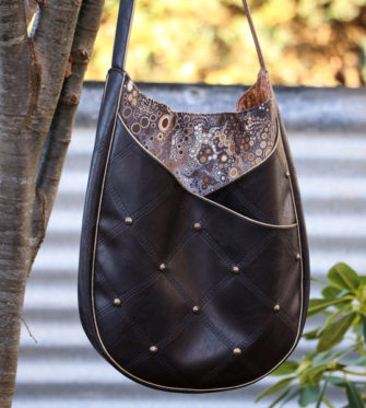 Leather and gold piping make up this S & S Tote - Andrie Designs