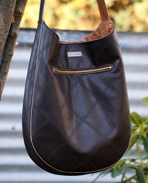 How great is that metal zipper on the back of the leather and gold piping S & S Tote - Andrie Designs