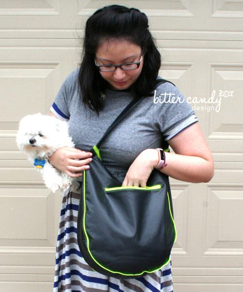 The back zipper pocket is a great size on this black with lime contrast S & S Tote - Andrie Designs