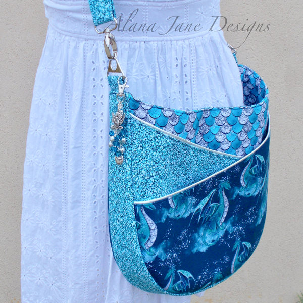 Side view of the dragons and scales for this S & S Tote - Andrie Designs