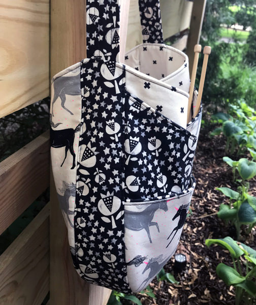 Side view of the black and white unicorns S & S Tote - Andrie Designs