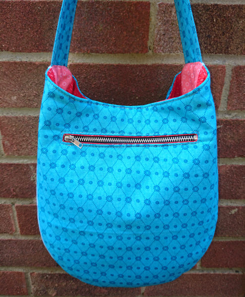 Rear view of the blue and peach S & S Tote - Andrie Designs