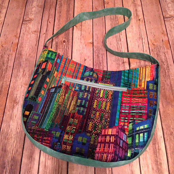 Cityscape on the back of the teal green, orange and yellow S & S Tote - Andrie Designs