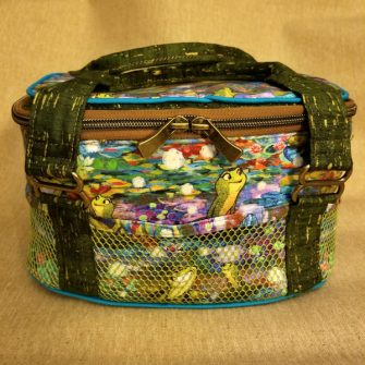Peekaboo Frogs on this Bree's Box Toiletry Caddy! - Andrie Designs