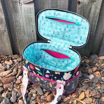 Two zipper pockets are on the inside of the Bree's Box Toiletry Caddy - Andrie Designs
