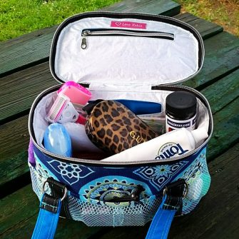 Inside view of the blue and black Bree's Box Toiletry Caddy - Andrie Designs