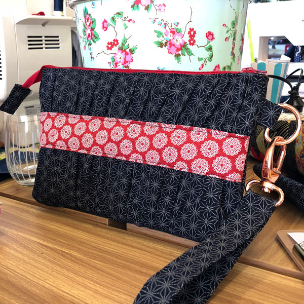 Floral navy print and floral red print, along with rose gold hardware for this Gather Me Up Clutch - Andrie Designs