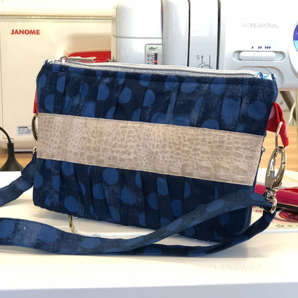 Navy spots and a neutral cork contrast panel for this Gather Me Up Clutch - Andrie Designs
