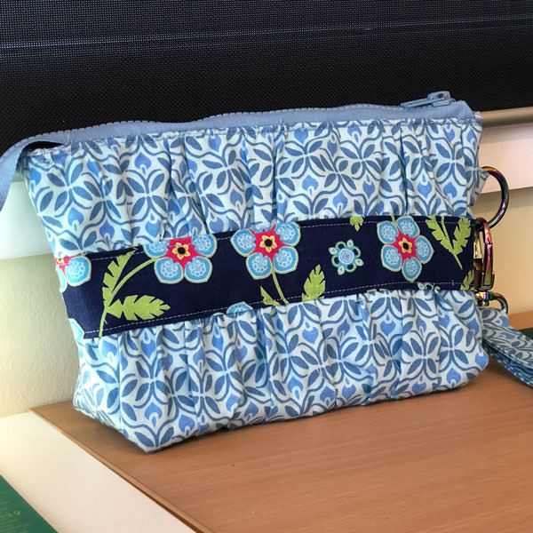 Blue floral with a navy floral contrast panel for this Gather Me Up Clutch - Andrie Designs