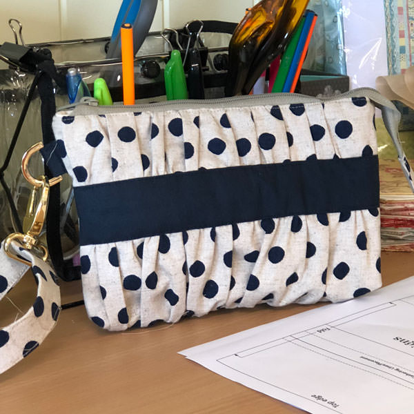 Spotty linen with a navy contrast for this Gather Me Up Clutch - Andrie Designs