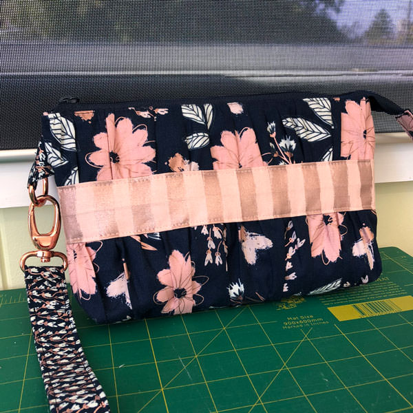 Navy and rose gold for the front of this gorgeous Gather Me Up Clutch - Andrie Designs