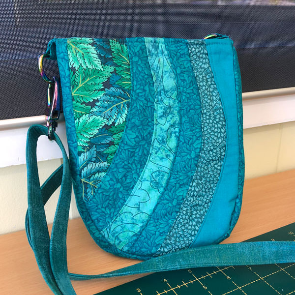 A stunning assortment of teals make up this Mini Shades Pouch - Andrie Designs