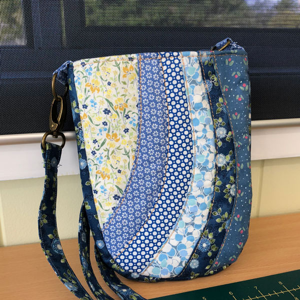 Blues and yellows make this Mini Shades Pouch - Andrie Designs