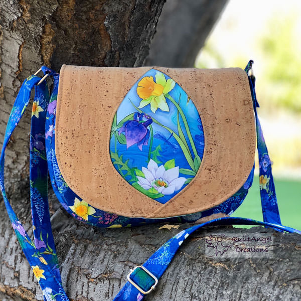 Beautiful nature-themed print paired with natural cork for this Peekaboo Purse - Andrie Designs