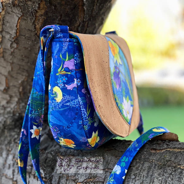 Side view of the beautiful nature-themed print and natural cork Peekaboo Purse - Andrie Designs