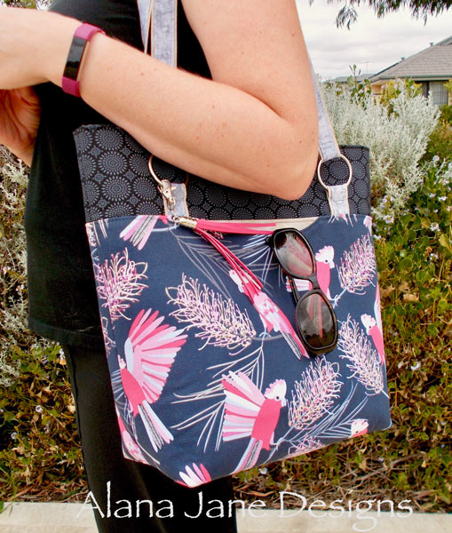 Action shot of the pink lorikeet Classic Market Tote - Andrie Designs