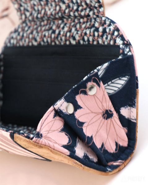 Rivets closed up the wings on the Blush Cleo Everyday Wallet - Andrie Designs