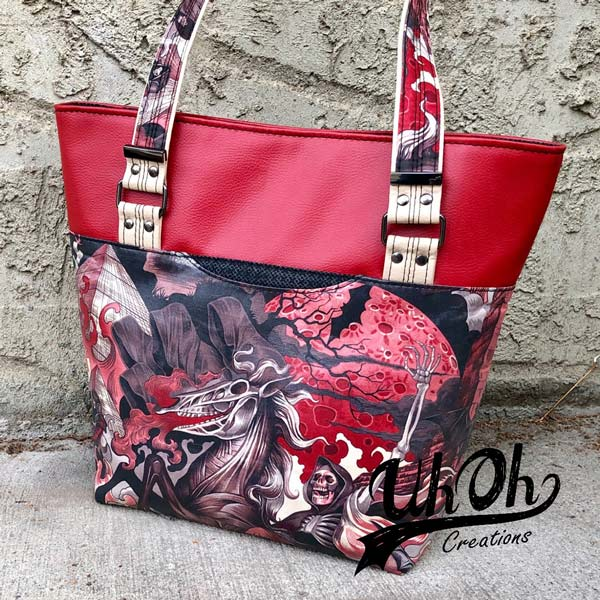 Angled view of the red vinyl and funky fabric Classic Market Tote - Andrie Designs