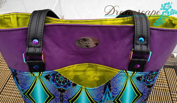 Outer slip pocket and iridescent hardware help make this Classic Market Tote pop - Andrie Designs