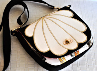 'Clamshell' motif in creams, blacks and gals - That Flap Saddlebag - Andrie Designs