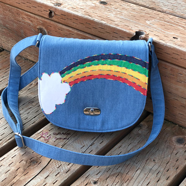 It's rainbow all the way for this 'rainbow' motif That Flap Saddlebag - Andrie Designs