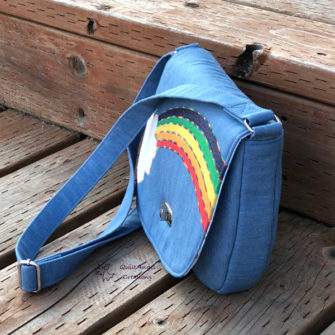 Side view of the 'rainbow' motif That Flap Saddlebag - Andrie Designs