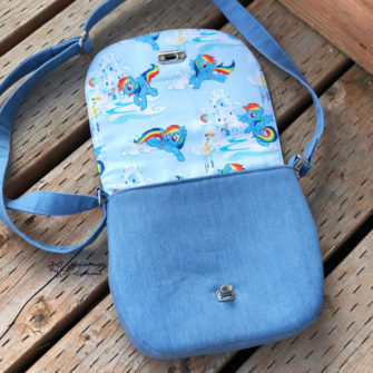 Open view of the 'rainbow' motif That Flap Saddlebag - Andrie Designs