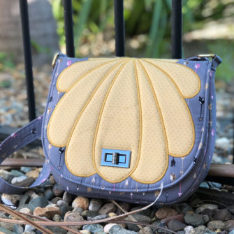 Grey and gold 'clamshell' motif That Flap Saddlebag - Andrie Designs