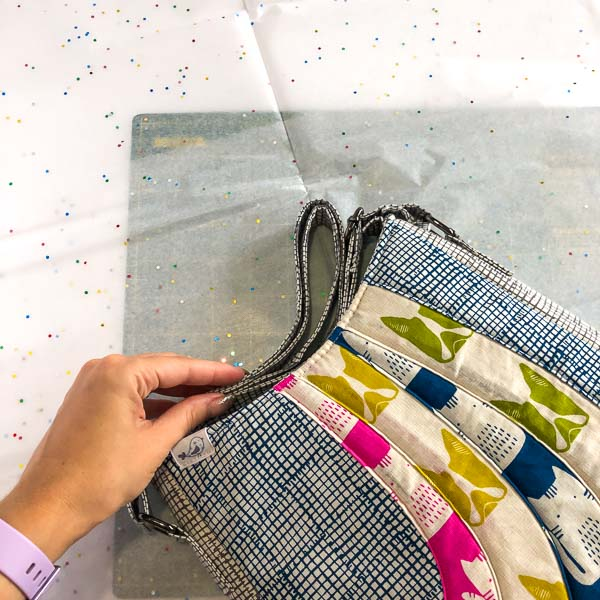 Folding of the strap - Shipping Handmade Bags - Andrie Designs