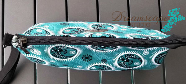 Birds eye view of the teal and black V Pouch - Andrie Designs
