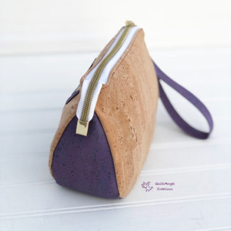 Darling zipper tab on the floral and cork V Pouch - Andrie Designs