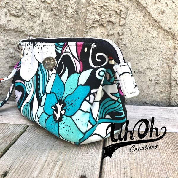 Side view of the bold floral V Pouch - Andrie Designs