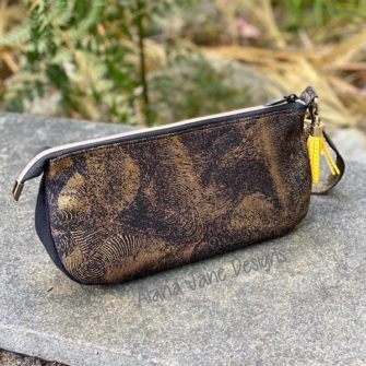 Striking black and gold V Pouch - Andrie Designs