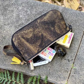 Black and gold V Pouch in use - Andrie Designs