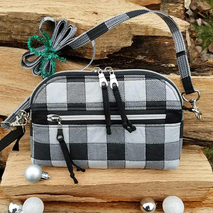 Rear view of the festive black and white Gemma Carryall Pouch - Andrie Designs