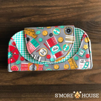 Front view of the sewing-themed Cleo Everyday Wallet - Andrie Designs
