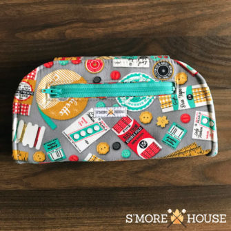 Back view of the sewing-themed Cleo Everyday Wallet - Andrie Designs