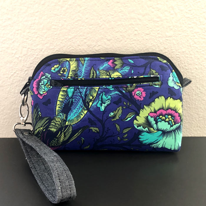 Rear view of the navy floral Gemma Carryall Pouch - Andrie Designs