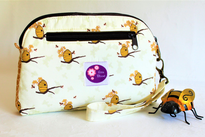 Rear view of the bumblebee Gemma Carryall Pouch - Andrie Designs
