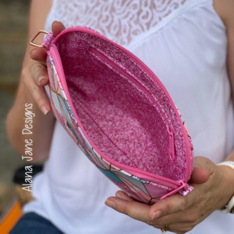 Inside the pink and sparkly Gemma Carryall Pouch - Andrie Designs
