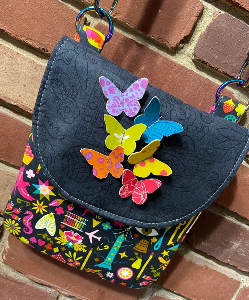 Stunning butterflies in flight Polly Cross Body Pouch - Andrie Designs