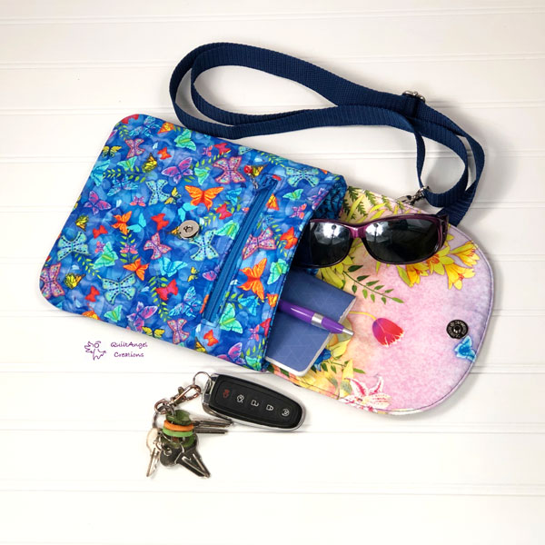 Open view of the butterflies-themed Polly Cross Body Pouch - Andrie Designs
