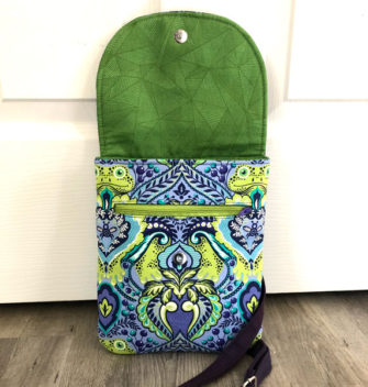 Flap open on the blues and greens Polly Cross Body Pouch - Andrie Designs